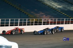 Otto Sitterly (7) and Dave Shullick Jr. battle Tim Snyder in the Mr. Supermodified feature