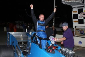Dave Shullick Jr. emerges from his winning Futuri Media No. 2 supermodified (Robert J Clark photo)