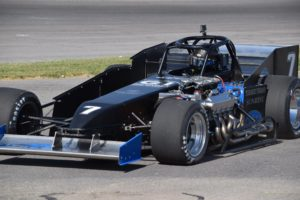 Otto Sitterly's No. 7 exiting Oswego Speedway during practice on June 16 (Bob Lacelle photo)