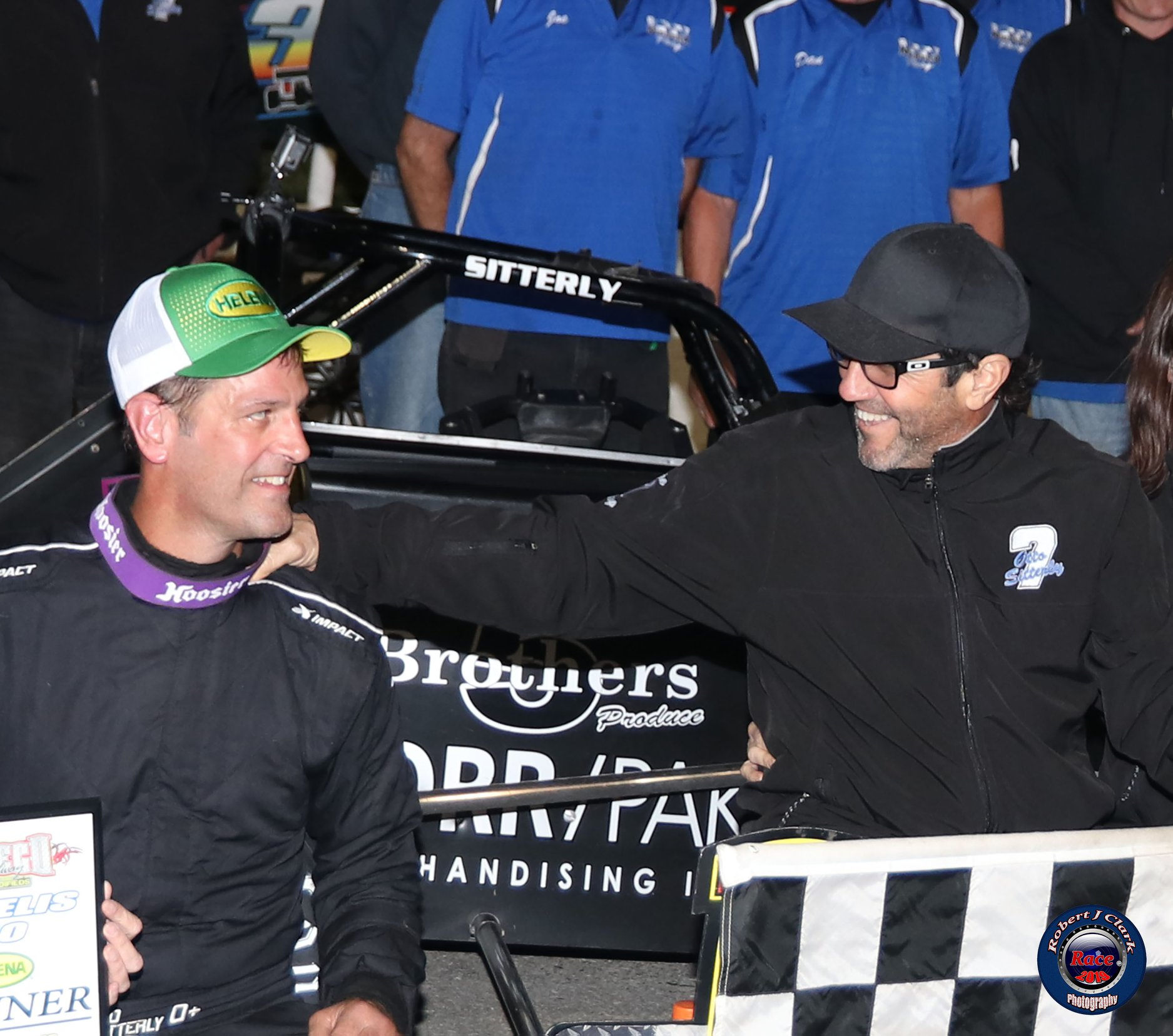 Car owner John Nicotra congratulates Otto Sitterly on another Oswego Speedway Supermodified feature win (Robert J Clark photo)