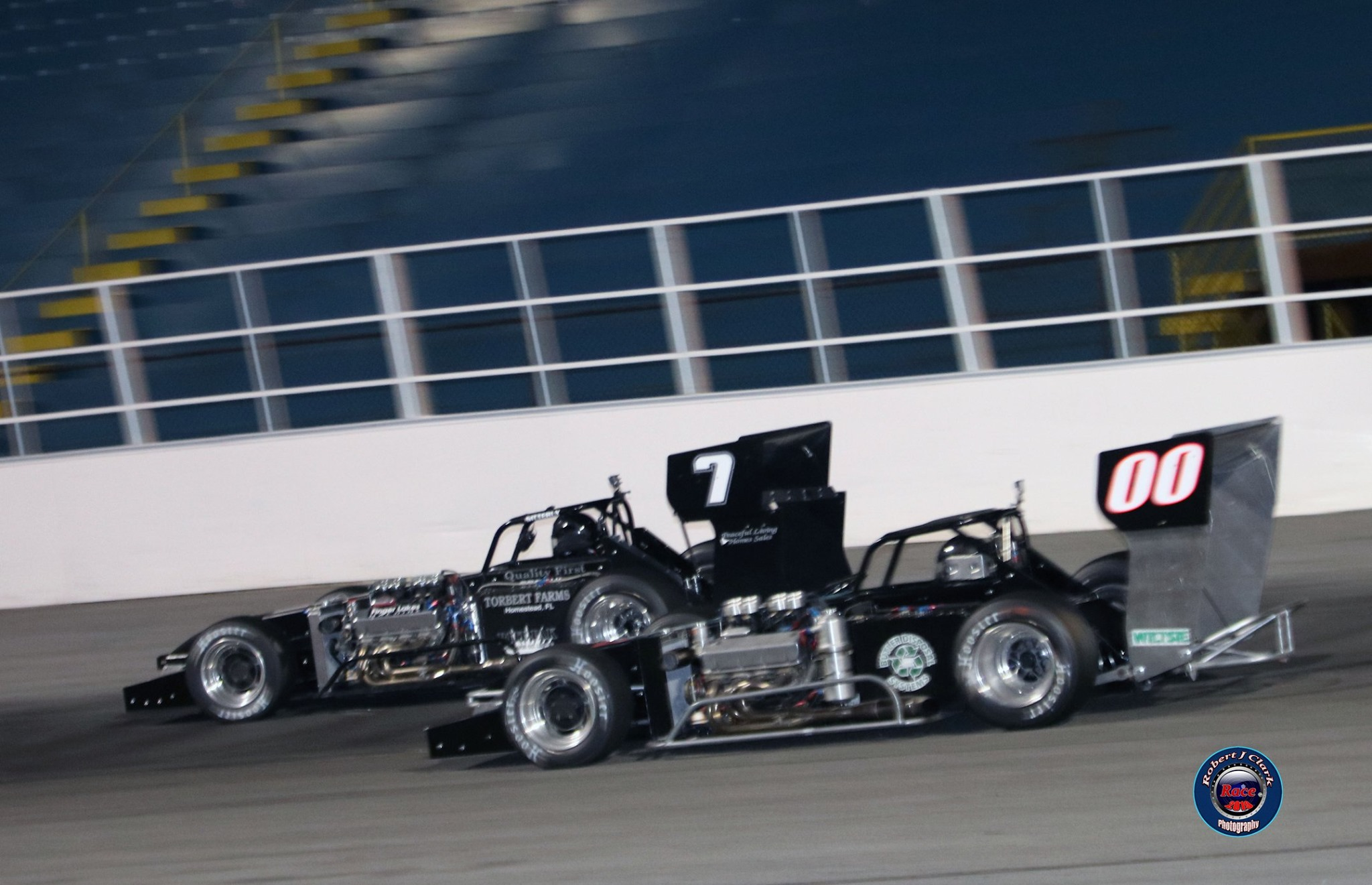 Otto Sitterly races past Joe Gosek midway through the Mr. Supermodified feature